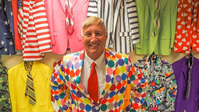 Rus Wilson, the late Portsmouth High School athletic director/city recreation director, is seen in this June 2017 photo, showing off some of his famous colorful suits.