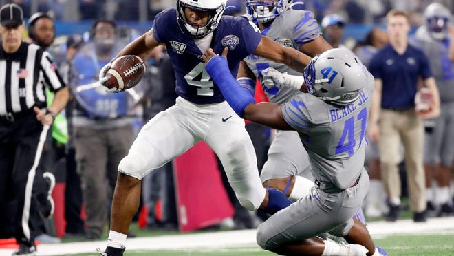 Penn State's Journey Brown (4) pushes off Memphis' Sanchez Blake Jr. (41) as he rushes the ball Saturday, Dec. 28, 2019, during the Goodyear Cotton Bowl Classic at AT&T Stadium in Arlington, Texas.122819cottonbowl32