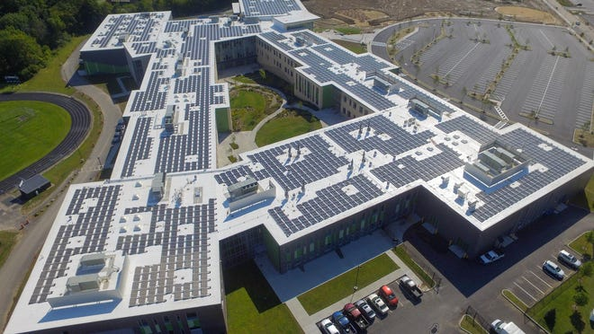 "Dover High School has the largest roof-mounted solar array in New Hampshire. The array is providing ""a small net cost savings for the community,"" City Manager Michael Joyal said."