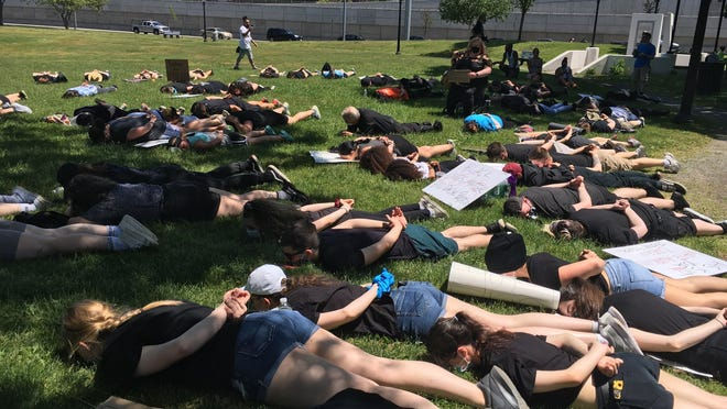 People protest peacefully at Heritage State Park in Fall River Thursday, June 4.