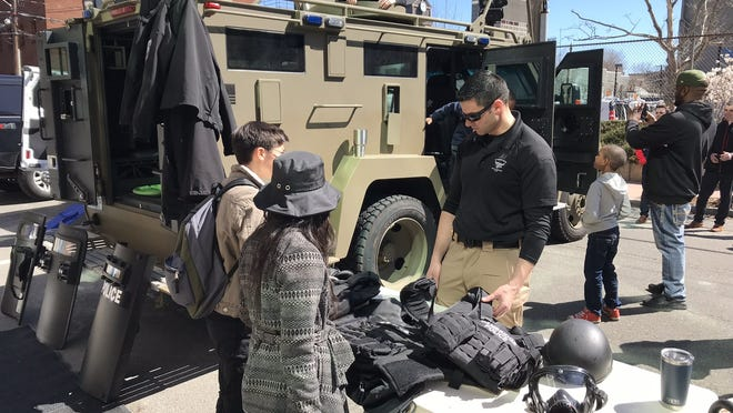 """Cambridge Police Department has one """"multi-purpose emergency rescue vehicle,"""" which is sometimes brought to city events, like the 2019 Cambridge Science Festival in this picture, to give residents a chance to see it first-hand and ask questions. CPD said the rescue vehicle is used for training as well as possible scenarios involving dangerous subjects or hazardous environments."""