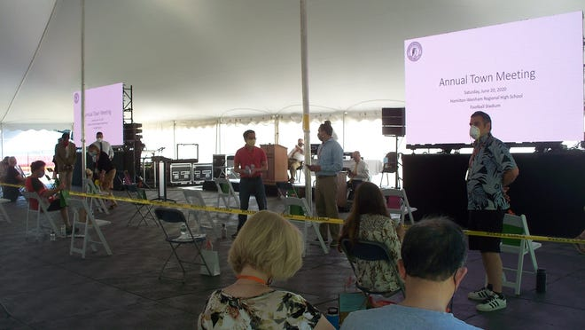 Hamilton Town Meeting was held Saturday, June 20 under a tent at the high school field.