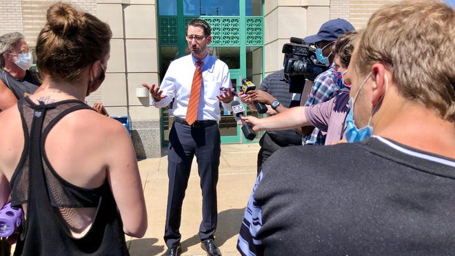 Rockford Mayor Tom McNamara speaks with protesters on Monday, June 8, 2020, outside of City Hall. Demonstrators are asking for all city police officers to be equipped with body cams and for funding to be reallocated to police-integrated mental health interventions and training.