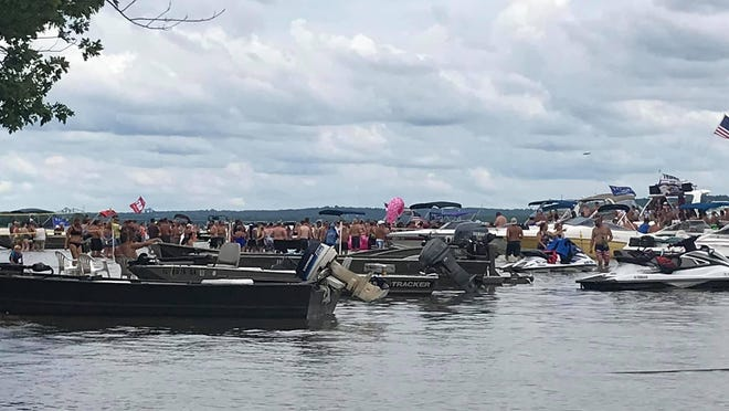 "Boats crowd together during the ""White Trash Bash"" annual event on the Illinois River on Saturday, Aug. 1, 2020."