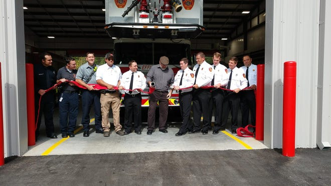 A fire house was un-coupled instead of a ribbon being cut at the dedication of the new station.