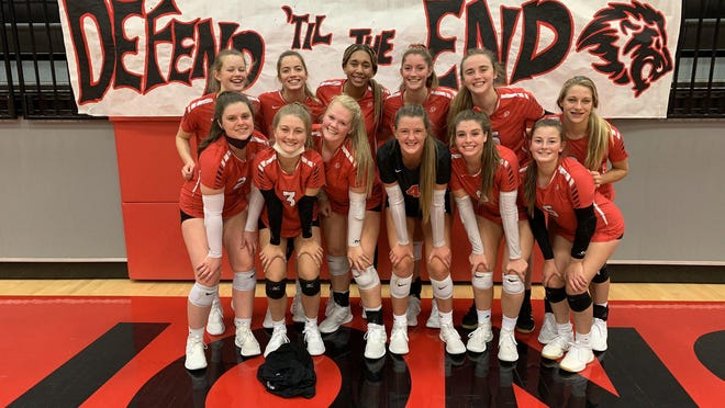 Shown is the Lansing Lady Lions volleyball team following their state quarterfinal win against Seaman Tuesday.