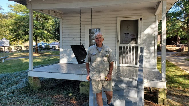 Jeff Russell stands in front of the birthplace of Elvis Presley in Tupelo, Mississippi, a stop off during his 444-mile walk of the Natchez Trace Parkway.
