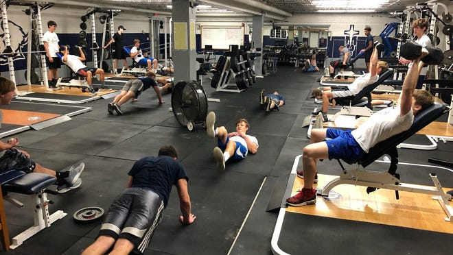 TMP-Marian athletes work out in the weight room. TMP and Hays High both began summer workouts this week.