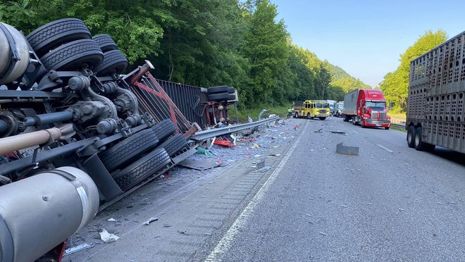 The driver of this tractor-trailer died at the scene Friday near mile marker 61 on I-26 East after the tractor-trailer struck a guardrail and overturned.