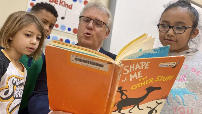 Superintendent Bo Caldwell reads to Clear Creek Elementary students March 6 during Read Across America Week.