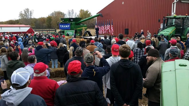 Hundreds of spectators gathered outside the main barn at the Elgin and Joanne Darling Farm in Maybee Tuesday night to hear Eric Trump campaign for his father, President Donald Trump. The family used John Deere machinery, semi-trucks and other farm implements to form a perimeter around the viewing area.