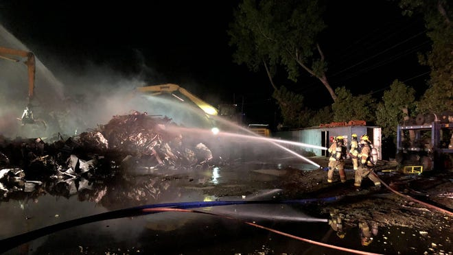 Holland's three fire stations were on the scene of a fire in scrap steel early Friday, June 12.