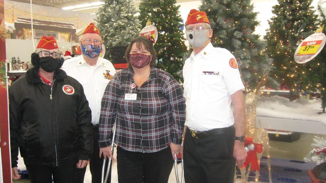 St. Joseph County Marine Corps Detachment No. 1401 worked in conjunction Monday with Meijer to bring a Merry Christmas to area children in need. In the photo are, from left to right, Julia Bolte, chaplain; Steven Gary, paymaster-adjutant; Donna Johnson, Meijer sales associate and Rodney Bolte, Commandant of St. Joseph Marine Corps Detachment No. 1401.