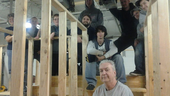 Instructor Tom Knuckles, front, with students from the 2013-14 Enzweiler carpentry program.