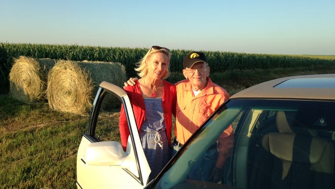 Becky Anthony and her father, Richard Benz, pause on one of father and daughter's annual harvest inspections of fields Benz once farmed near Melvin, in Osceola County.