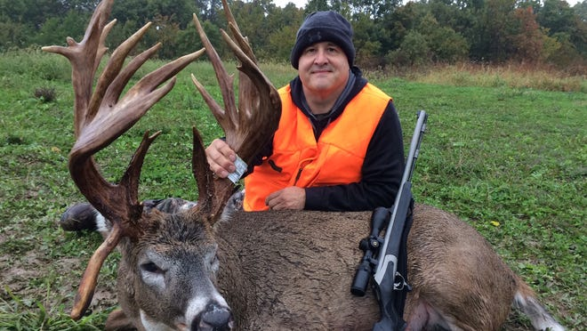 Joe Franz of Clive proudly poses with the trophy buck Palmer that he killed in October.