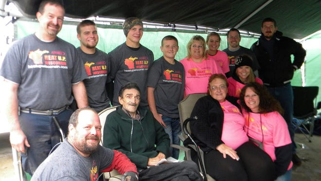 """The crew that helped install a new furnace for Cleon """"Pete"""" and Darlene Rhoades, sitting."""