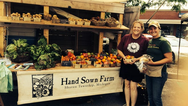 """Becky Burns of the Sunflour Bakehaus, shown here at the Farmington farmers market, helped organize """"Gathering for a Greater Good: Rekindling Kindness"""" Sunday, June 25, from 2 to 5 p.m. in Riley Park."""