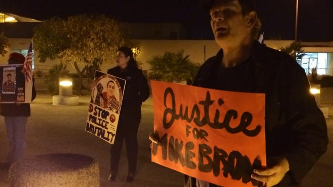 """Community members gathered outside the Larson Justice Center in Indio on Thursday for a """"Black and Brown Lives Matter"""" vigil."""