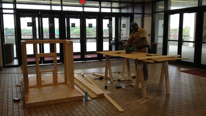 A SkillsUSA Florida Conference carpentry competitor handles a circular saw in the Bay Center's East Concession Concourse Tuesday afternoon. The contest was originally scheduled to be held outside the Bay Center, but inclement weather brought a dozen events inside.