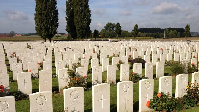 """Tyne Cot Cemetery in Belgium is the United Kingdom's largest war graves cemetery and a reminder of the 500,000 soldiers who died in West Flanders in 100 days in 1917. Most of the nearly 12,000 dead are identified only as """"Known unto God""""."""