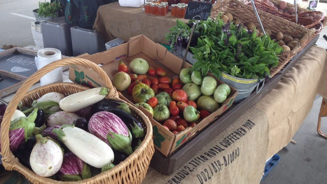 Fresh produce grown by Red Hills Small Farm Alliance member Orchard Pond Organics in northern Leon County, is sold weekly at the Market Square farmer's market on Saturday mornings and online through the Red Hills online market.