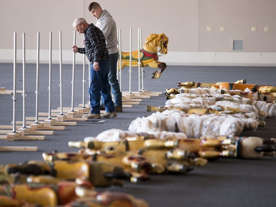John Lowe (left), and Dalton Stepnowski, both of Reading, Michigan, work on setting up an auction this coming Saturday at the Indianapolis Motor Speedway of items that had been housed at the track, and in Terre Haute, Indianapolis, Wednesday, March 8, 2017.