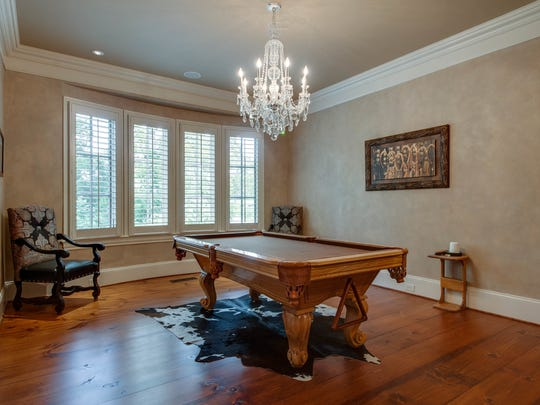 "The sellers of this $2.25 million house in Thompson's Station (4805 Toll Bridge Way) installed a pool table in their dining room because they didn't need a ""formal"" dining space. However, the new owners can easily convert the room back to formal dining."