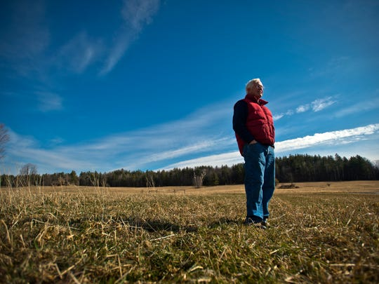 Charles Siegchrist looks out over land at Barber Farm in Jericho. With his wife Jean, the two have been growing vegetables solely for Vermont Foodbank, Chittenden Emergency Food Shelf and some smaller food shelves.