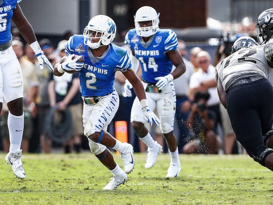 "Memphis defender Terrell ""TJ"" Carter (middle) bring back an interception against the UCF offense during second quarter action of the the AAC Championship football game in Orlando, Fl., Saturday, December 2, 2017."
