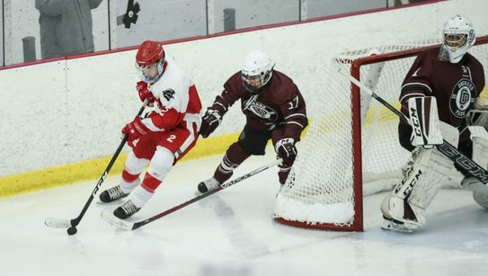 North Rockland's Eric Dunn (2) skates the puck behind