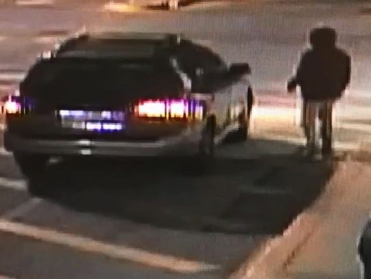 Police are searching for a suspect who they say robbed