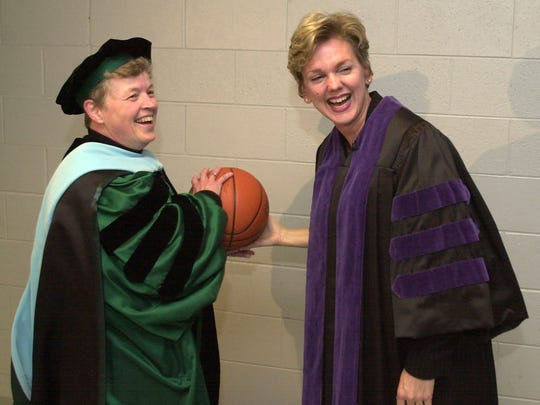 Then-Provost Lou Anna Simon jokes around with then-Gov. Jennifer Granholm before the convocation ceremony at the Breslin Center in 2003.
