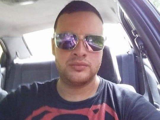 Jose Rios, manager of Mi Caldero, Puerto Rican restaurant
