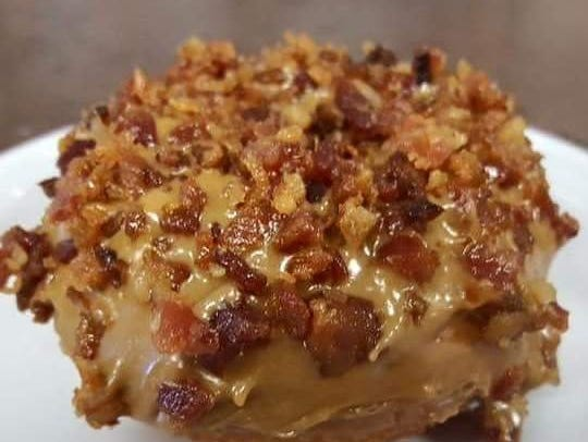 The Maple Bacon donut at Beignets in Denville.