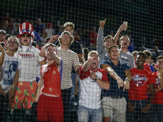 Urbandale student fans celebrate a Class 4A state baseball