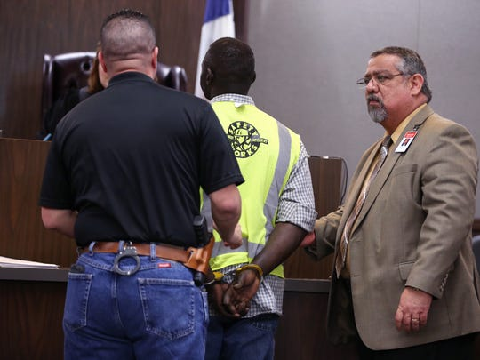 A man on probation in the domestic violence court is taken into custody for a 72-hour jail sanction in 214th District Court Judge Inna Klein's courtroom on Friday, April 14, 2017. He was the first of many to appear before Klein Friday.