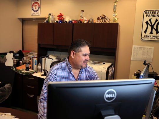 Gerardo Gomez, director of specialty clinics at Driscoll Children's Hospital, works in his office on Friday, Sept. 8, 2017.