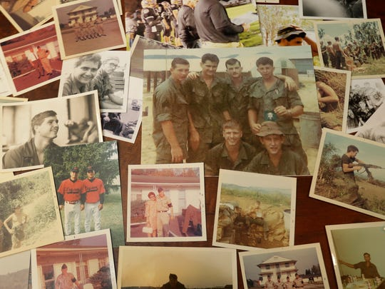 Former Army medic James McCloughan shows photos of himself and fellow soldiers in Vietnam.
