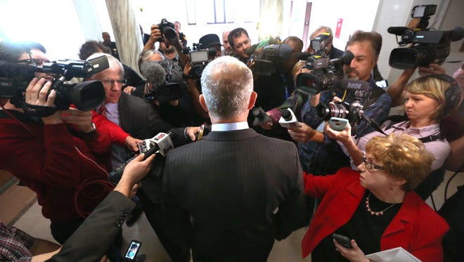 Hamilton Prosecutor Joe Deters is surrounded by media after Judge Megan Shanahan declared a mistrial in the Ray Tensing murder trial of Cincinnati motorist Sam DuBose. After nearly three days, the jury could not reach a verdict on either charge.