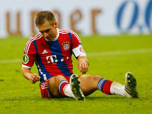 Bayern's Philipp Lahm has missed to score in a penalty shootout during the German soccer cup (DFB Pokal) semifinal match between FC Bayern Munich and Borussia Dortmund at the Allianz Arena in Munich, Germany, on Tuesday, April 28, 2015. (AP Photo/Matthias Schrader)