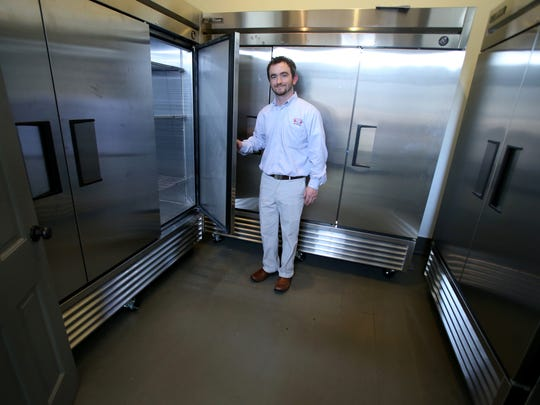 J.R. Stepherson shows the refrigerated units to keep