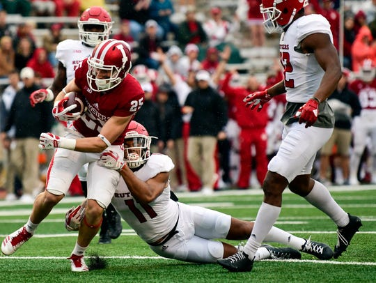 Indiana Hoosiers wide receiver Luke Timian (25) fought