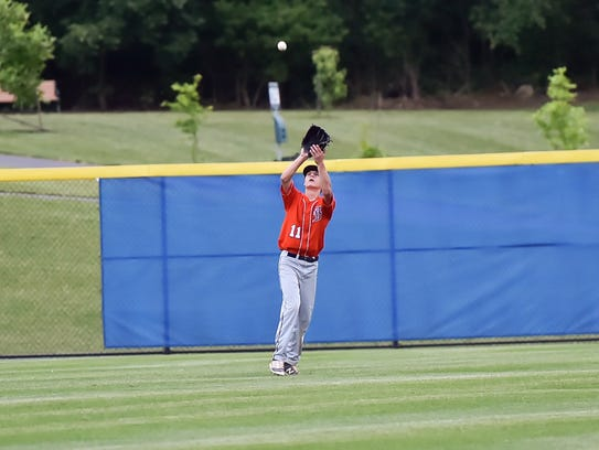 Fayettville's Kaden Hoover catches a flyball during