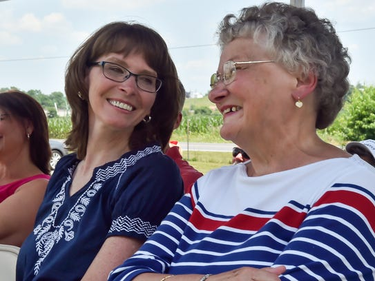 Penny Schur, left, smiles and turns to Judy Hartman