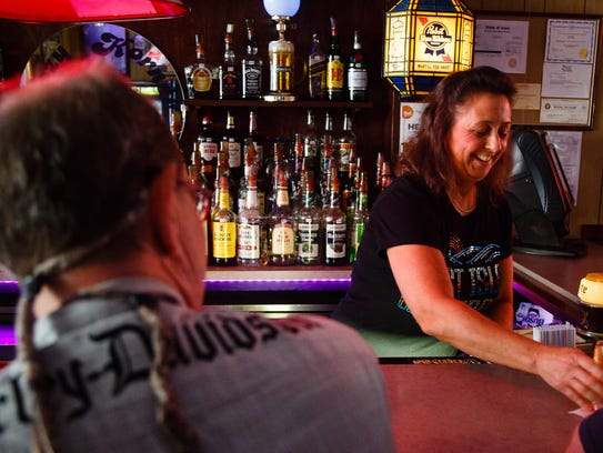 Leslie Pierson, 49, right, of Mason City, laughs with