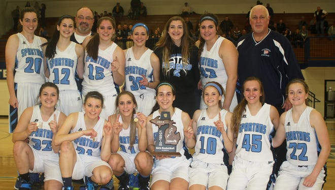 Members of the Livonia Stevenson girls basketball team celebrate with their newest piece of hardware – a Class A district championship trophy.