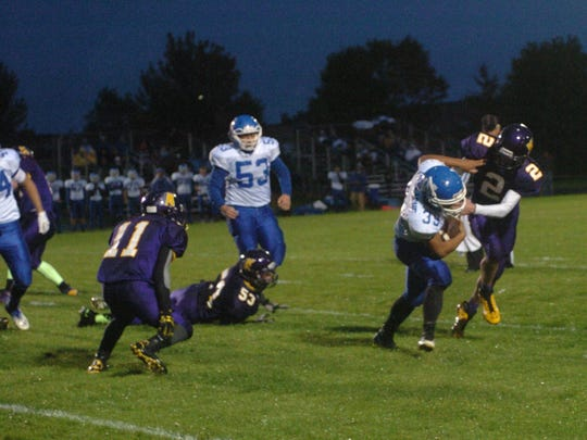 Wrightstown's Bryce Herlache runs the ball with Kewaunee's Noah Kleiman closing in during the Sept. 12 matchup in Kewaunee.