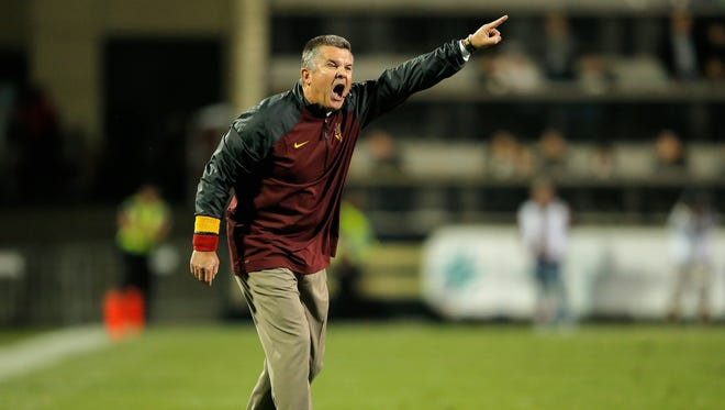 Head coach Todd Graham of the Arizona State Sun Devils leads his team against the Colorado Buffaloes at Folsom Field on Sept. 13, 2014, in Boulder, Colo. The Sun Devils defeated the Buffaloes 38-24.