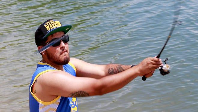 Angler Gabriel Salazar, of Bloomfield, casts his line Friday at Farmington Lake.